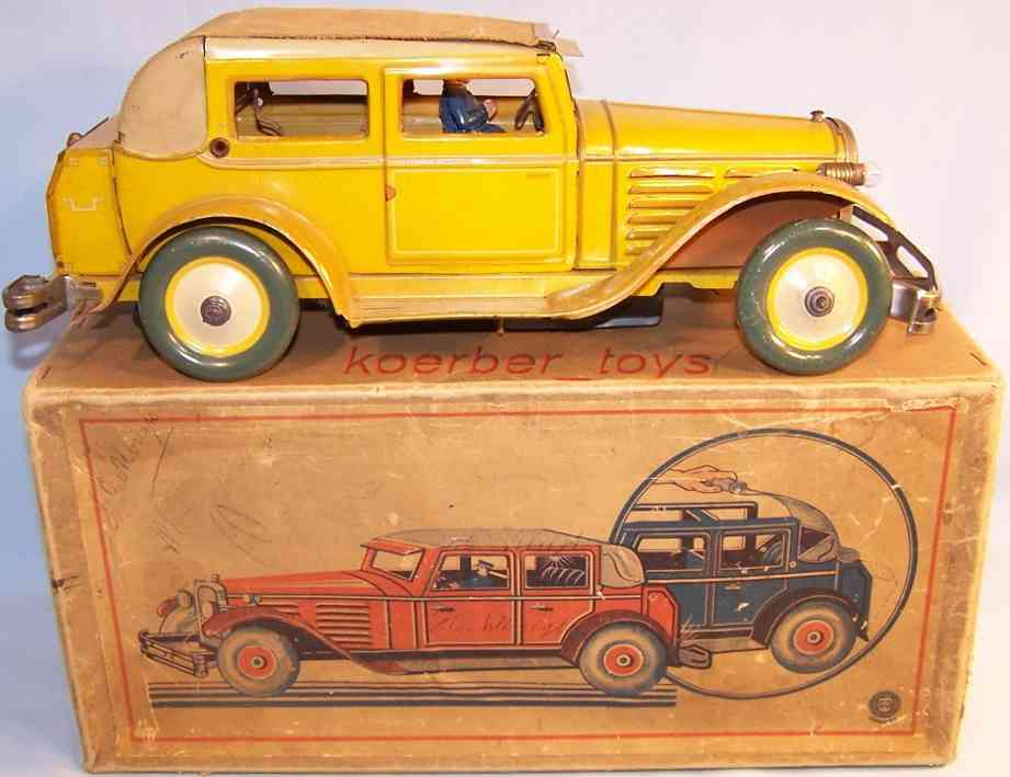 guenthermann 724 tin toy car rotation roof limousine clockwork yellow