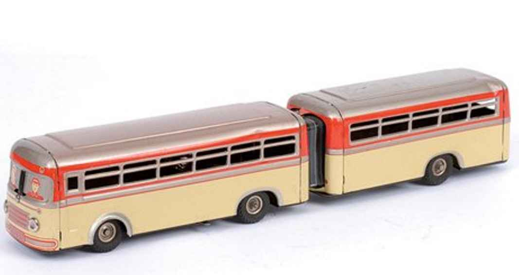 guenthermann 857 tin toy bendy bus with clockwork cream lower silver upper