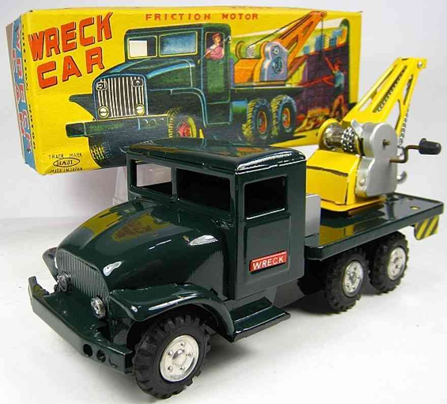 haji mansei toys co ltd tin toy truck friciton powered wrecker tow truck. the truck closely resemb