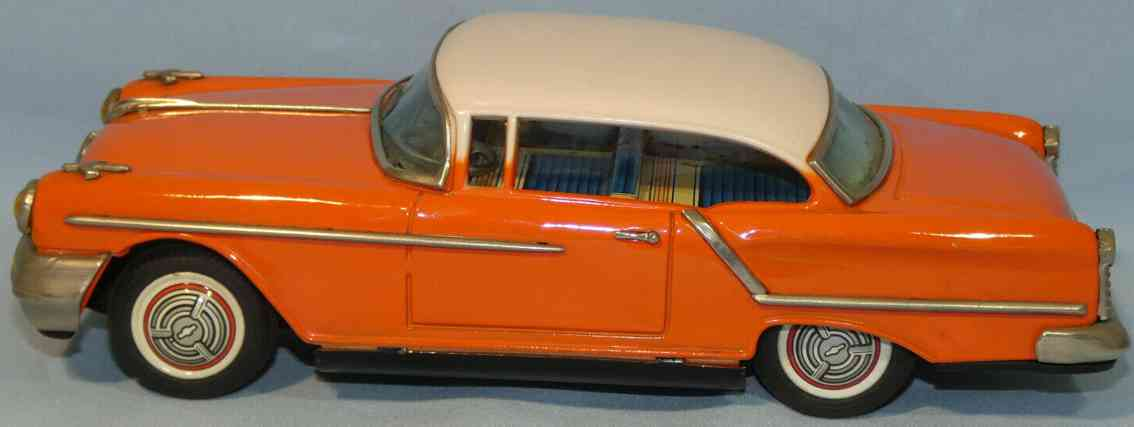 ichiko em-1957 tin toy car oldsmobile with flywheel drive orange