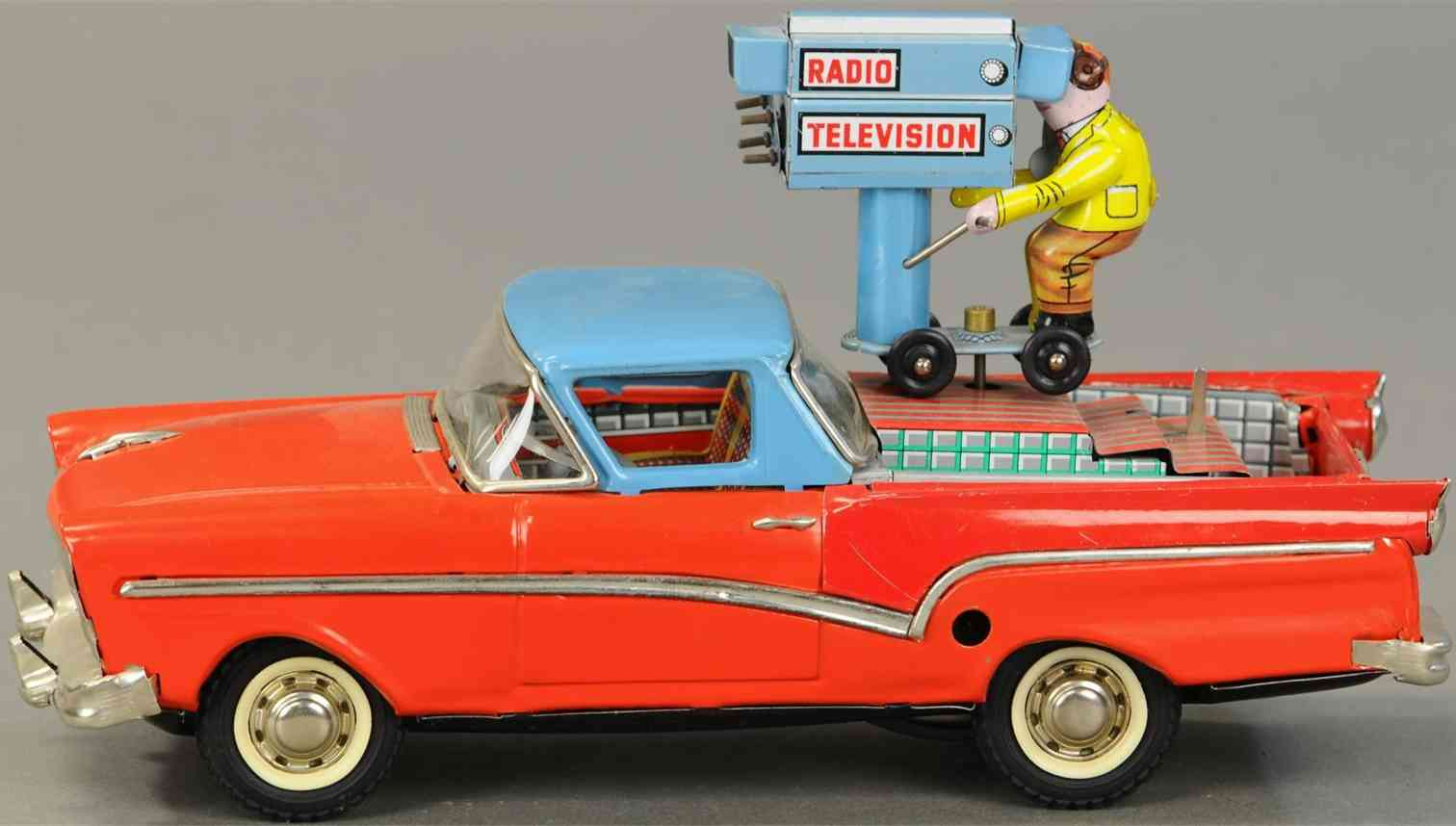 joustra tin toy radio television car friction operated keywind cameraman