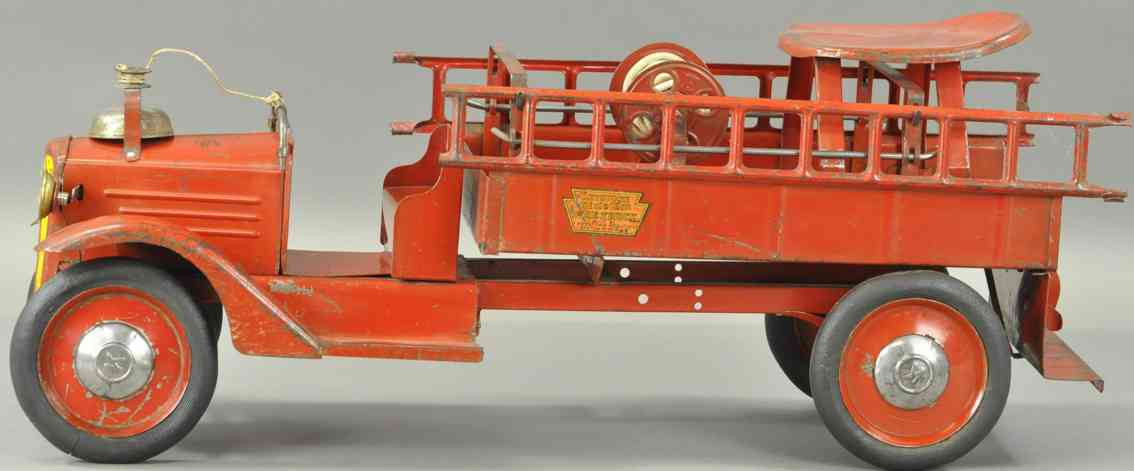keystone tin toy ride-em fire ledder truck with electric headlights