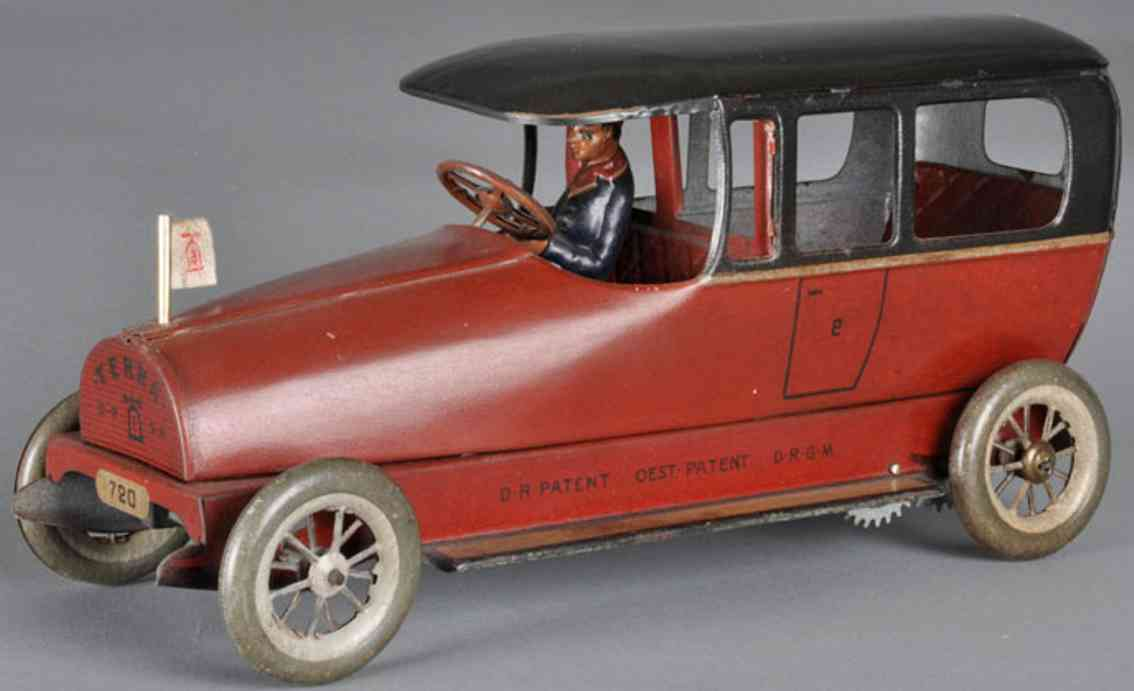 lehmann 720 tin toy terra windup car red