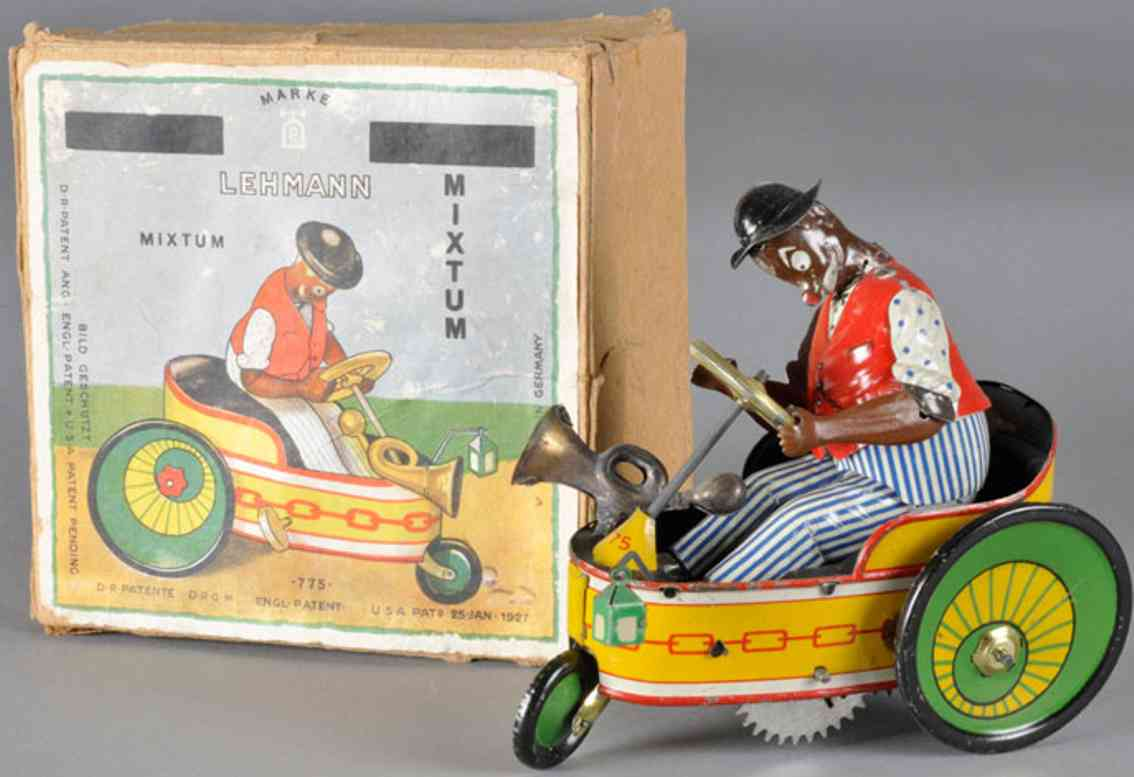 lehmann 775 tin toy car peter wind up eccentric three wheeled car black driver