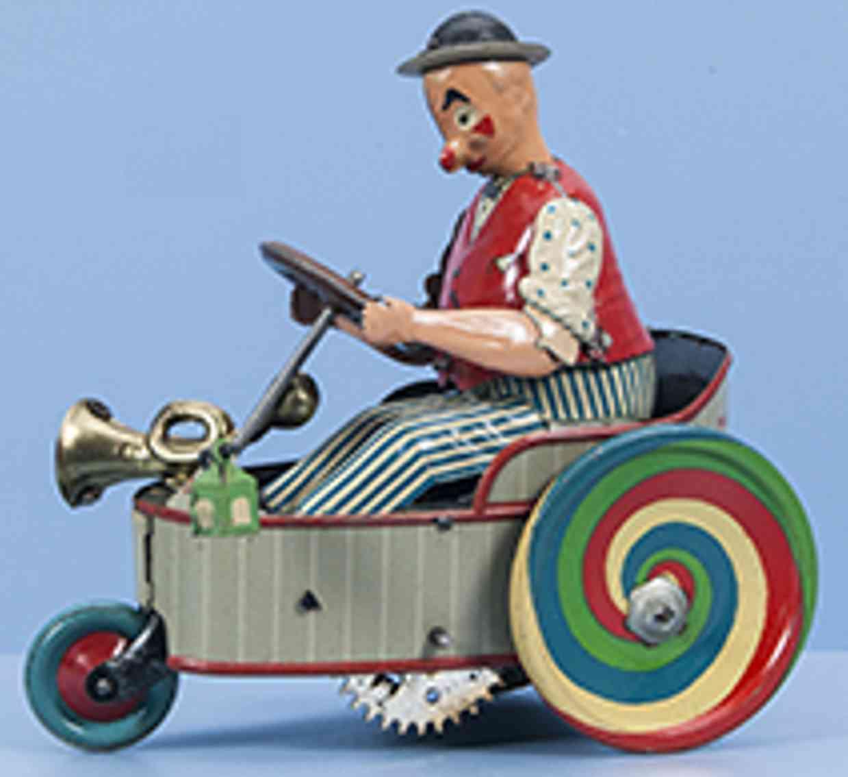 lehmann 775 tin toy car peter wind up eccentric gray three wheeled car white driver