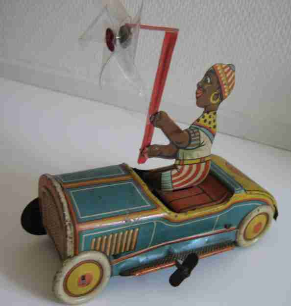 levy george gely tin toy car car with black boy and clockwork, wound up the car drives in