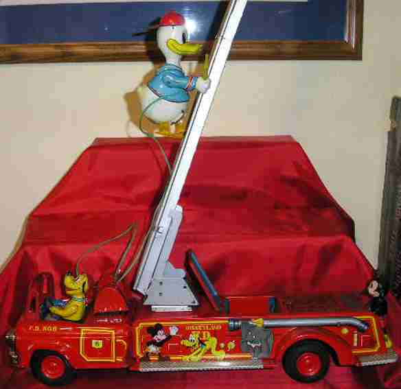 linemar tin toy fire engine battery operated donald with fire vehicle