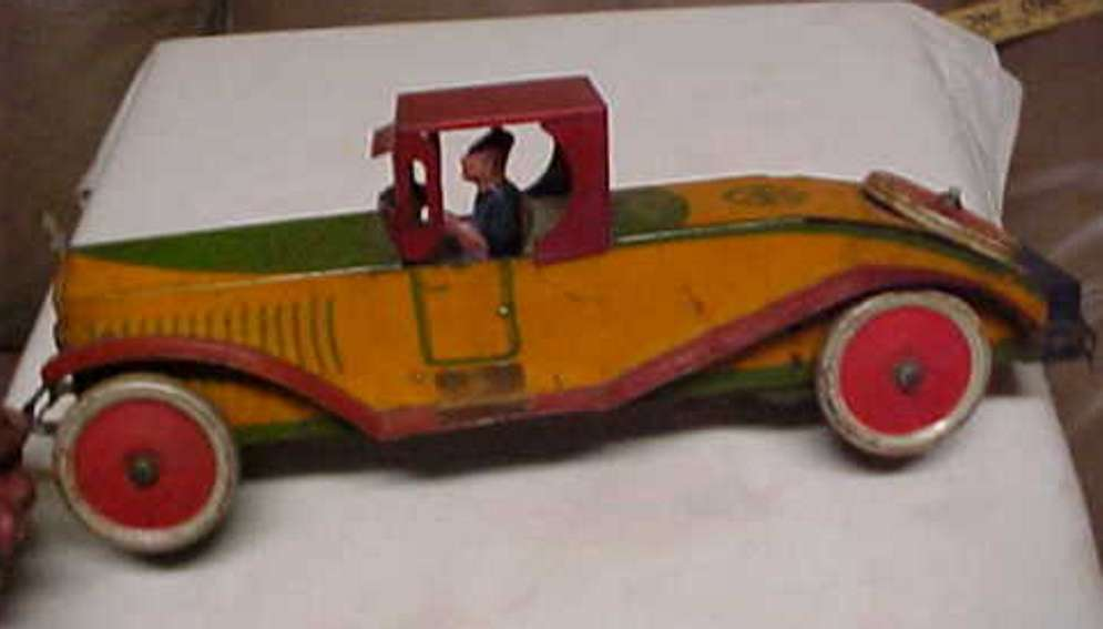 marx louis tin toy stutz wind-up car yellow red