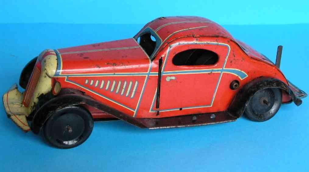 marx louis tin toy car clockwork red