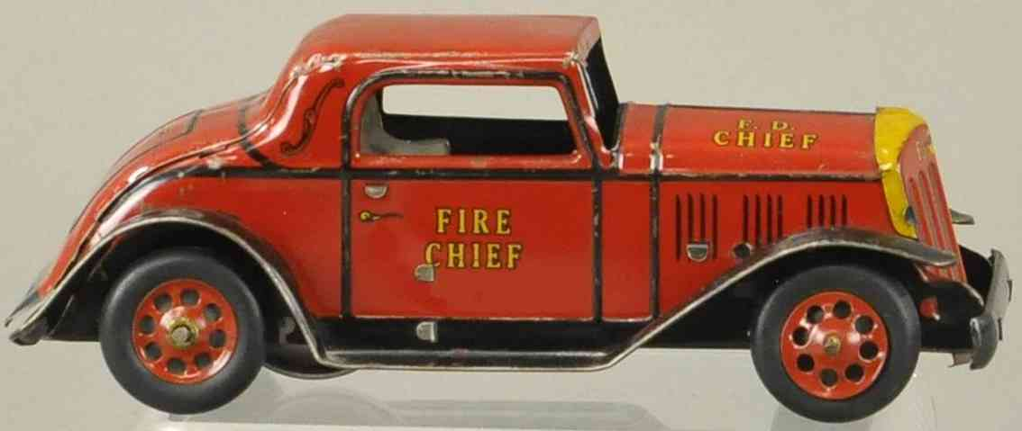 marx louis tin toy fire chief coupe in red and yellow