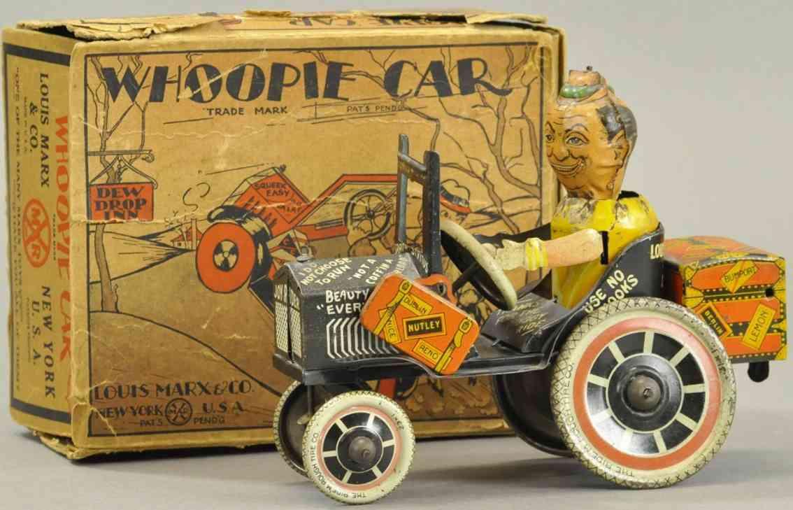 marx louis tin toy car whoopie car suitcase clockwork
