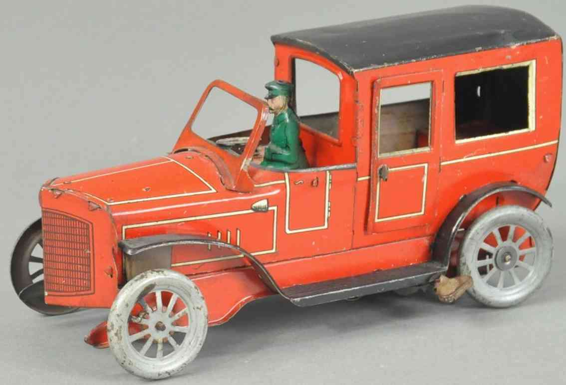 orobr tin toy car limousine red black chauffeur clockwork