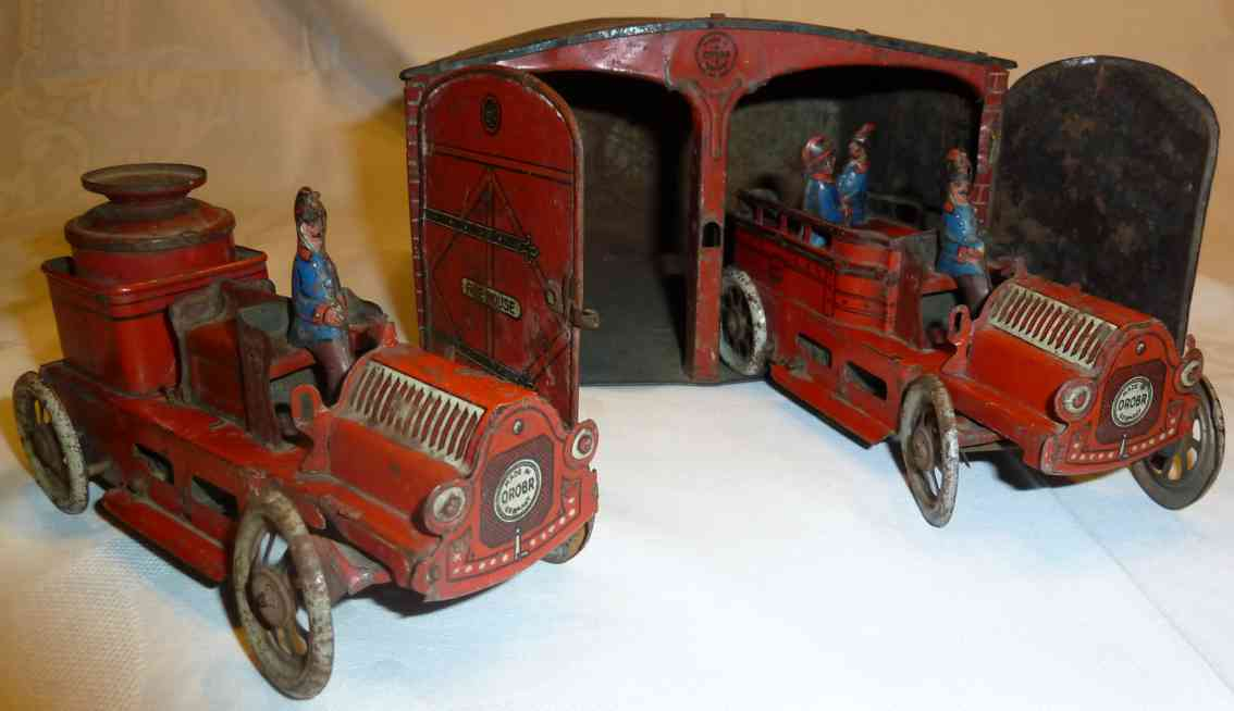 orobr tin toy fire station firefighters garage and two fire trucks
