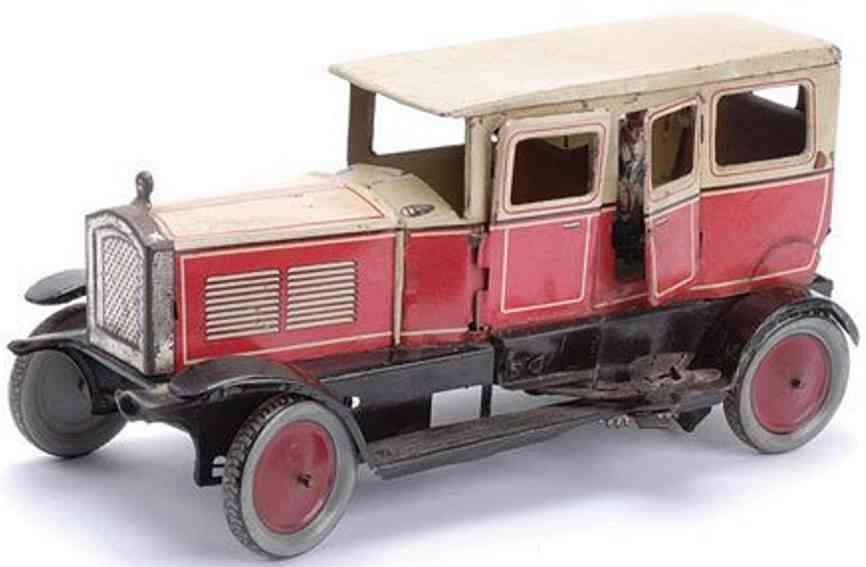 richard und co tin toy car limousine clockwork red cream