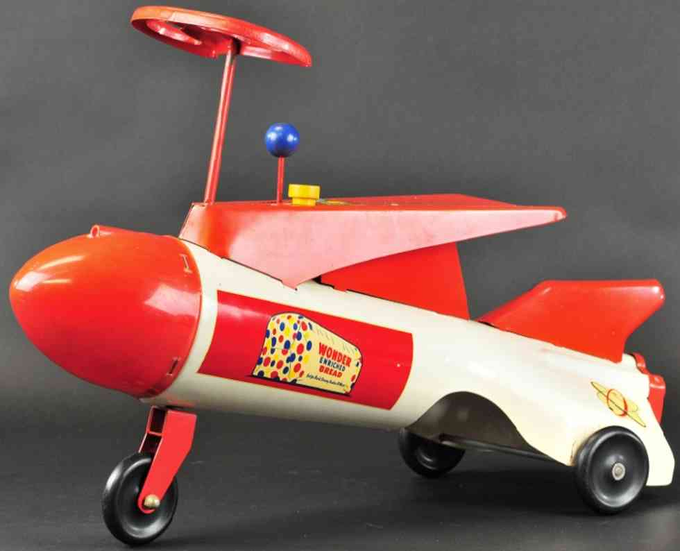 robert's manufacturing co pressed steel toy sit and ride rocket ship