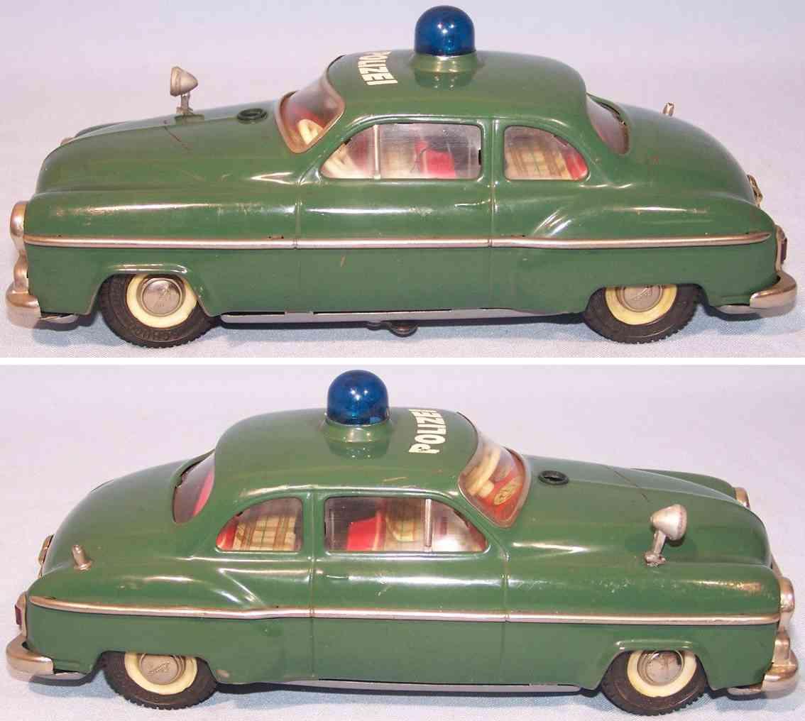schuco 5340 blech spielzeug auto polizeiwagen elektisch gruen