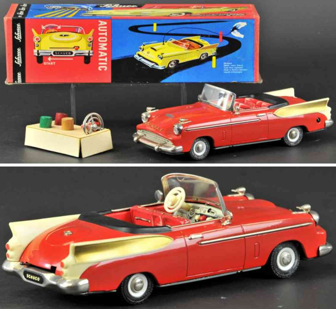 schuco 5700 tin toy car synchromatic packard rear fin cabriolet red