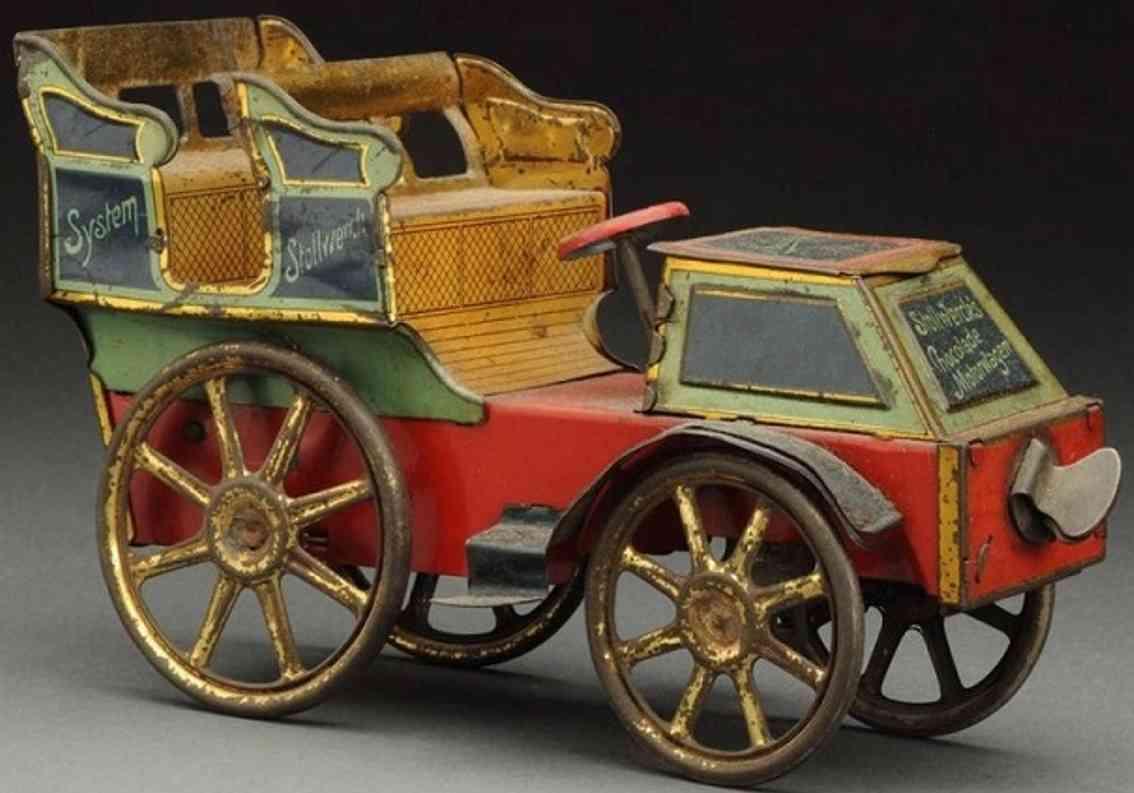 stollwerck blech spielzeug auto offener motorwagen zwei sitzreihen rot gruen