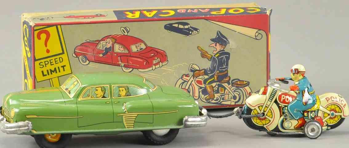 tkk tin toy motorcycle cop chasing car