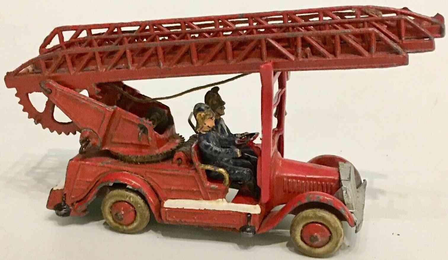 taylor & barrett toy die-cast turntable fire ladder engine with two fire fighters