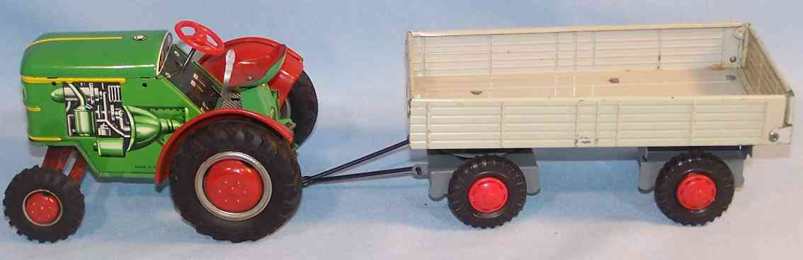 tippco 56 tin toy tractor with supporter, lithographed in green, red, gray and