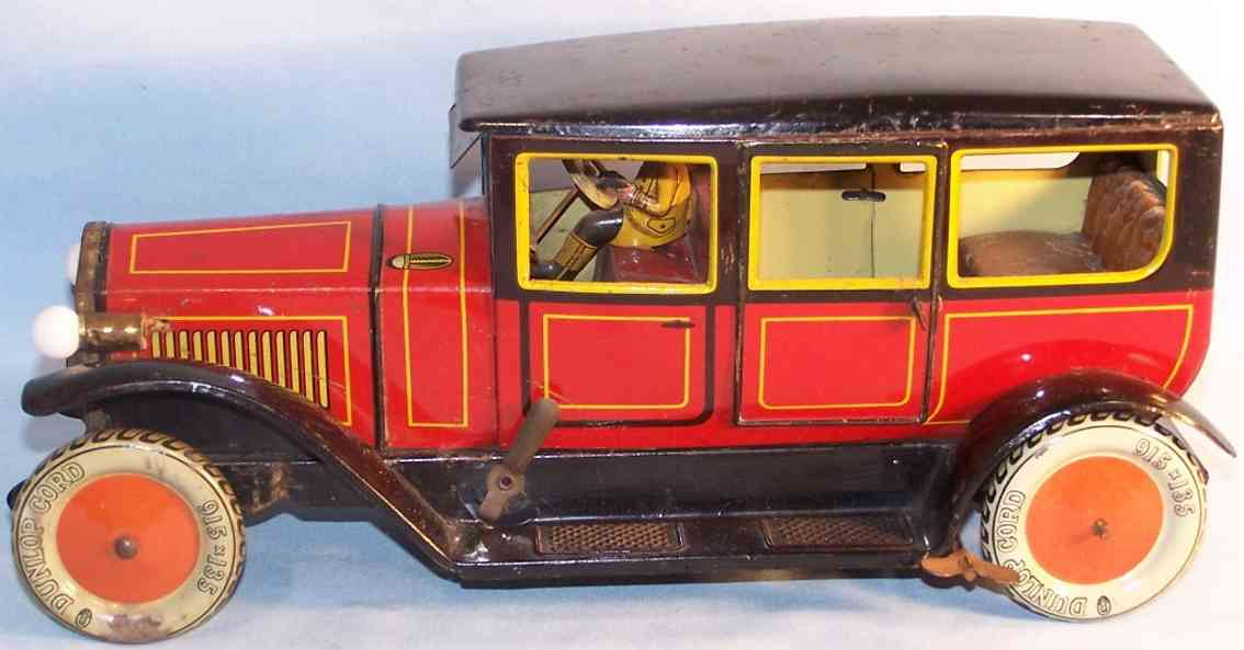 tippco 9502 tin toy car limousine with clockwork lighting red