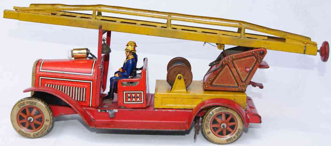 tippco tin toy fire ladder engine with clockwork and light