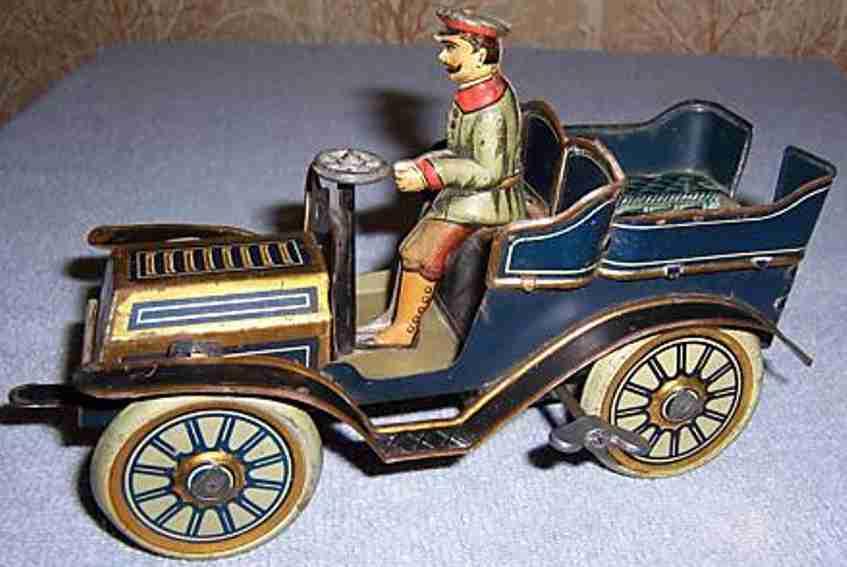 unknown blech spielzeug auto tourenwagen mit uhrwerk und fahrer, vielleicht von güntherma