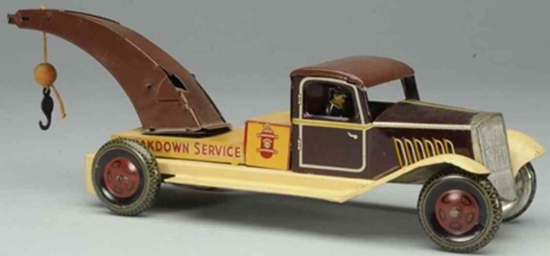 wells brimtoy tin tow truck wind-up toy