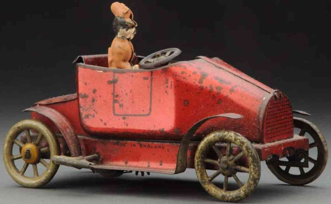whiteley tansley and company tin toy car early wind-up roadster red