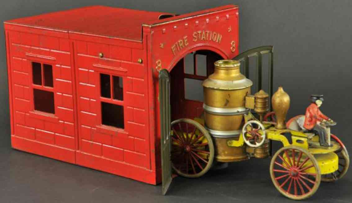 wilkens tin toy fire engine fire station and pumper, open service frame, contains seated