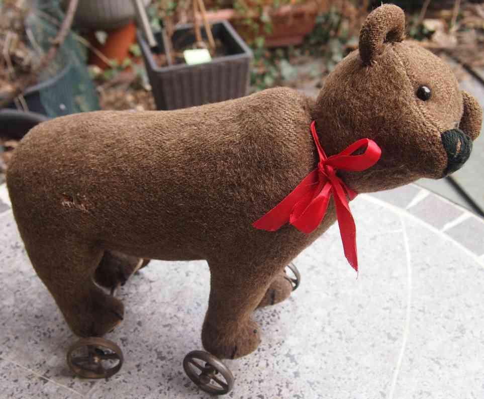 steiff bear brown bear on metal wheels