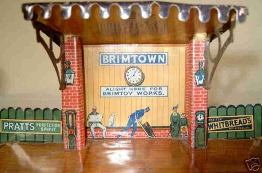 brimtoy toy railway station lithographed with advertising