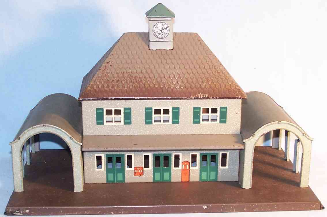 bub tin railway station toy with two side passages with arched roof