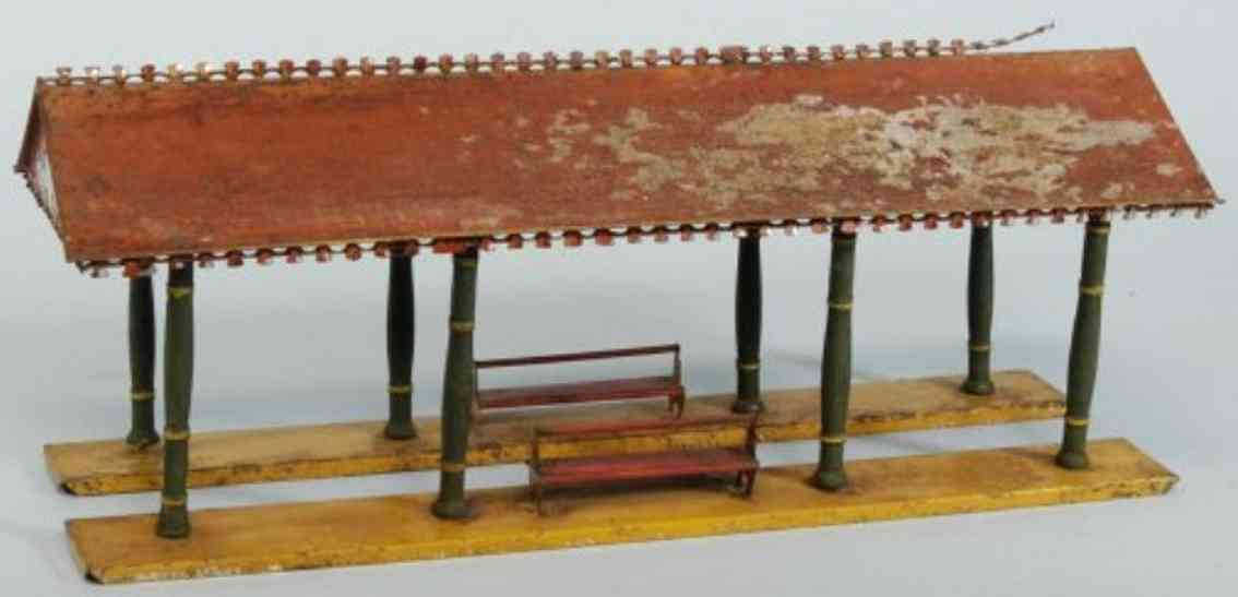 ives 117 (1903) spielzeug eisenbahn bahnsteig bahnhalle bahnsteighalle mit handbemaltem dach, sockel und bänken. die