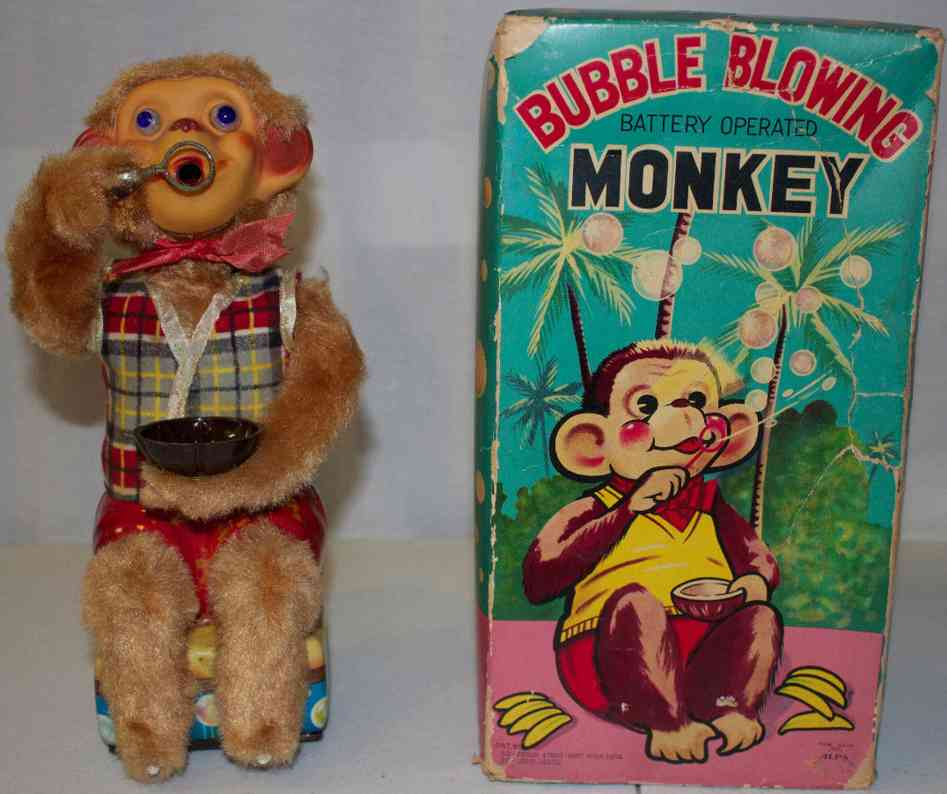 alps tin toy bubble blowing monkey battery operated toy