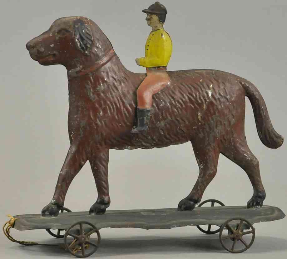 althof bergmann & co blech spielzeug junge reitet auf einem hund