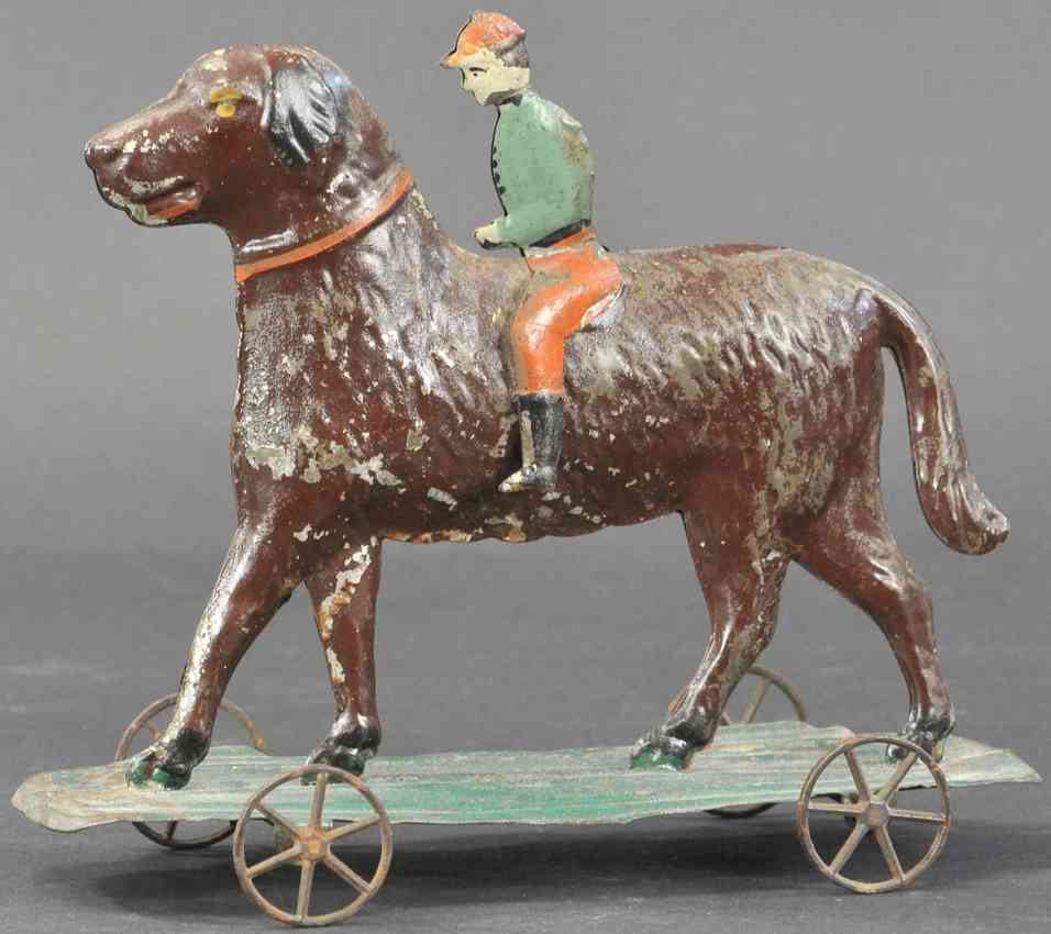 althof bergmann & co tin toy boy riding on dog