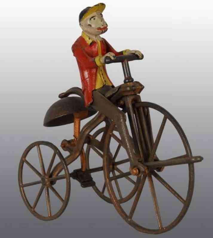 Affe auf Dreirad mit Glocke