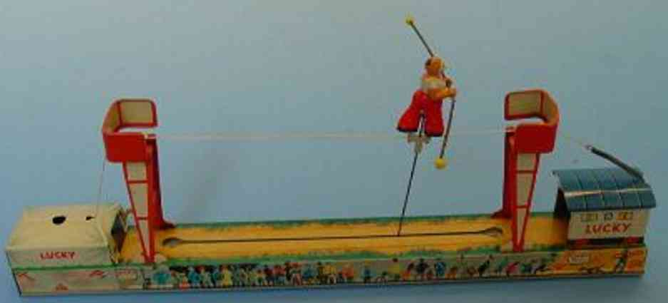 arnold 360 tin toy clown on high rope lucky