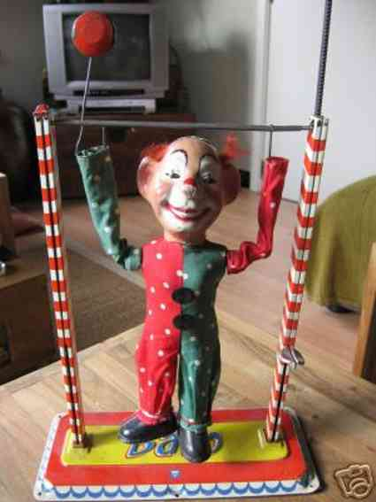 arnold 810 tin toy clown acrobat on a trapeze with spring