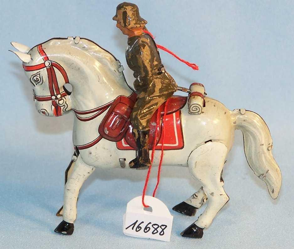 arnold blech spielzeug pferd mit soldat und uhrwerk, lithografiert und handlackiert