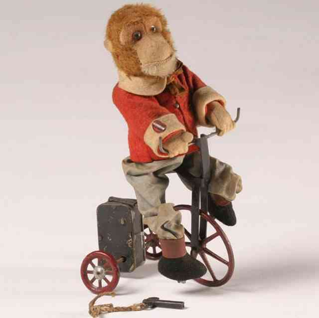 bing tin monkey riding tricycle windup toy mohair felt clothing