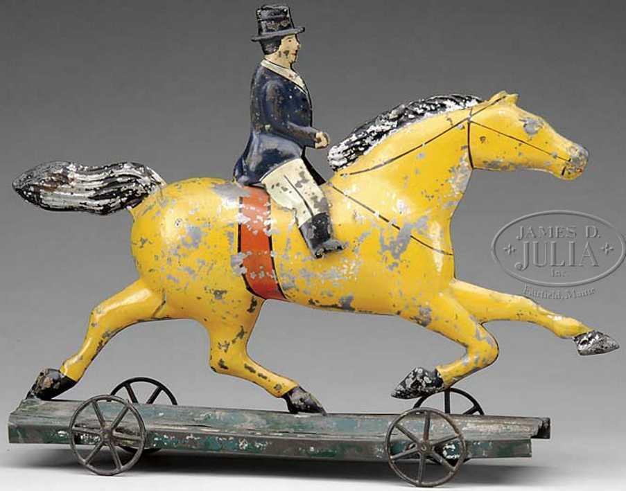 brown george tin toy dexter horse rider platform