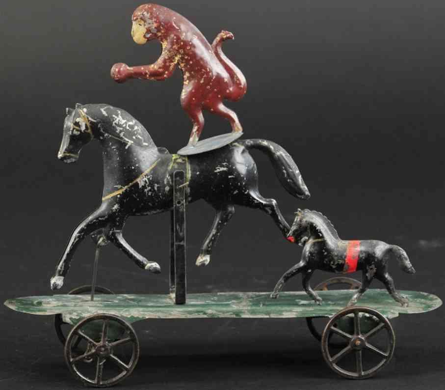 brown george blech spielzeug stehender affe auf einem pferd
