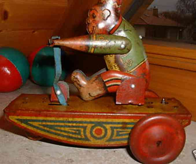 burnett ltd tin toy monkey on a tricycle with elevator mechanism, wound up the m