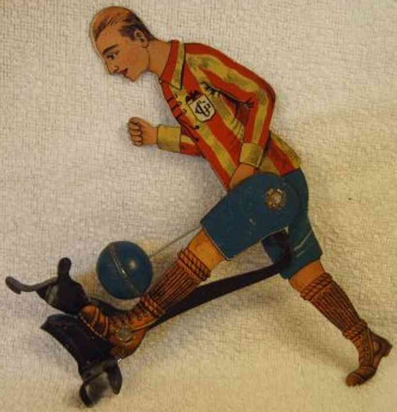carette tin toy football player