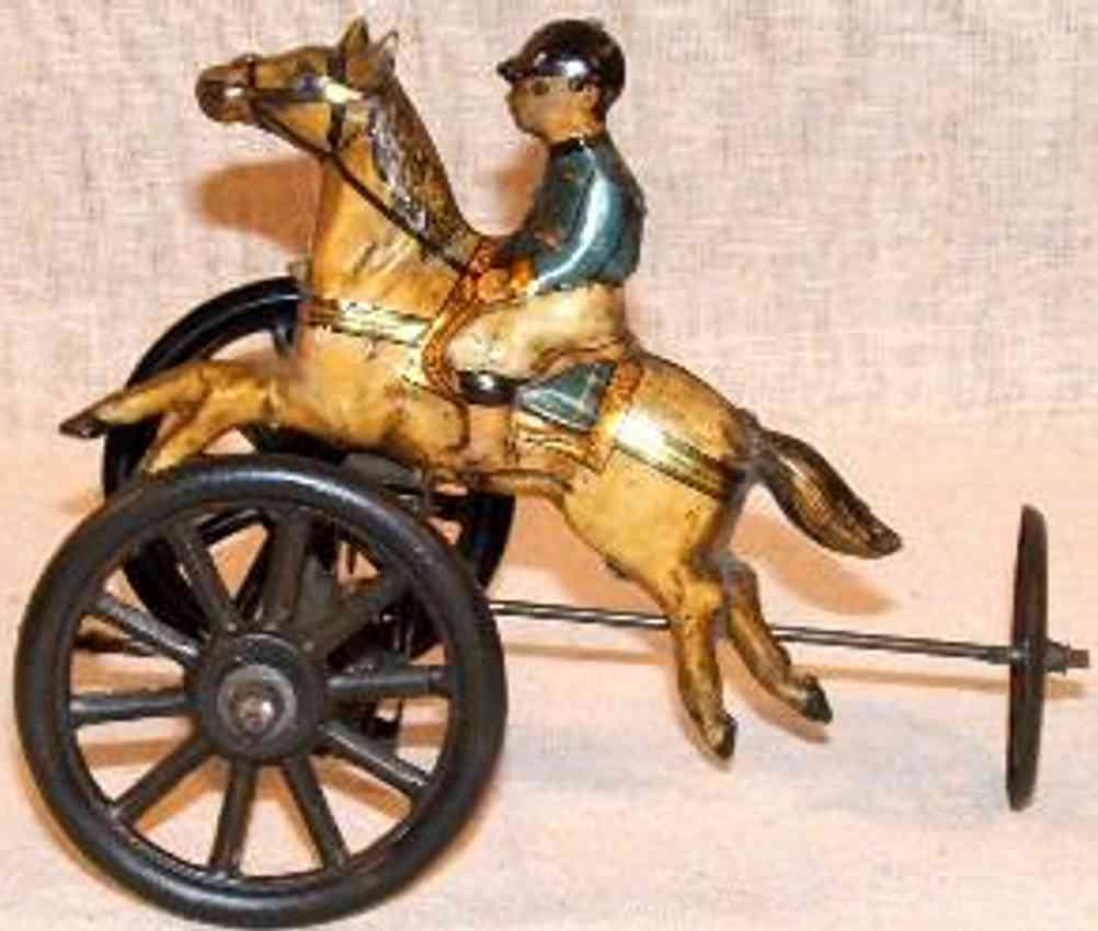 carette tin toy football player rider on horse three wheels clockwork
