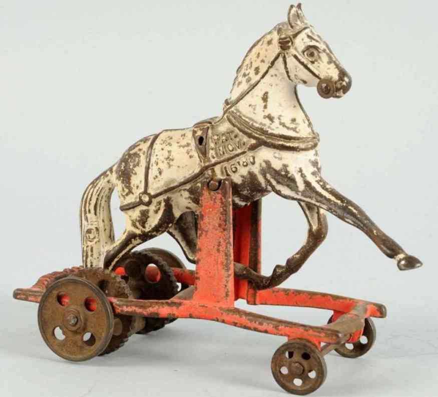 carpenter cast iron toy white horse on wheels