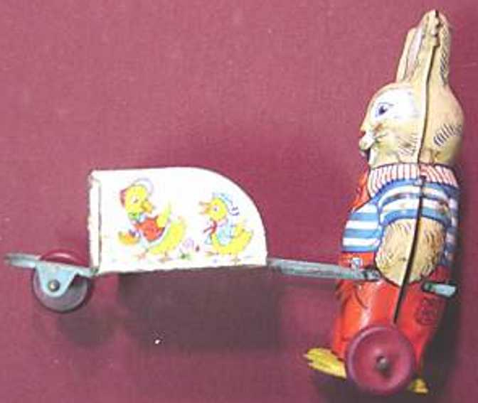 chein co 82 tin toy rabbit with wheelbarrow, lithographed, no wind-up mechanism,